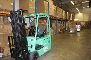 Forklift in goods in warehouse
